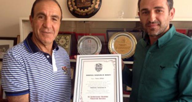 Ünsal'a onursal başkanlık beratı