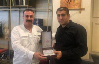 ŞİDEF'den, Murat Akın'a teşekkür plaket